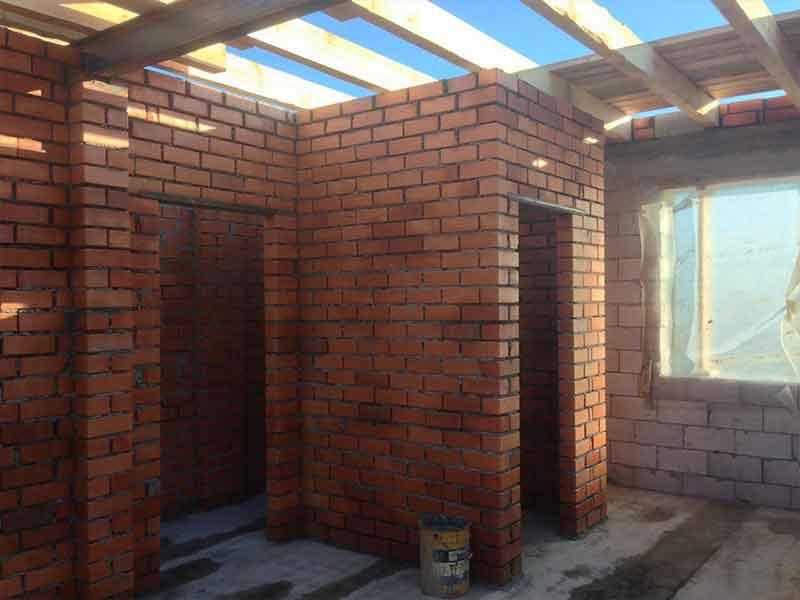 Строительство несущих стен дома из теплоблока